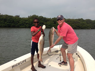 Picture of David and Adam Rhodes with some nice redfish